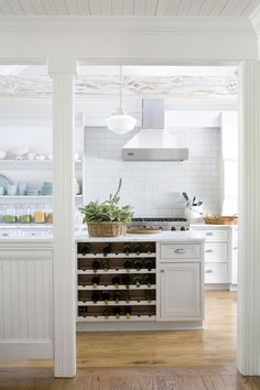 Open shelving and wine bar in island
