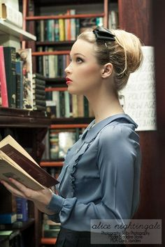 Model Madeline Stone reading in library wearing a smoky blue Colette Blouse by alice nightingale, Brisbane, Australia. Photograph by Selby Photography. This hand made smokey blue blouse features romantic frill, soft puff sleeves and lovely pearl buttons. Look Retro, Look Vintage, Mode Pop, Idda Van Munster, Sexy Librarian, Librarian Style, Retro Mode, Woman Reading, Up Dos