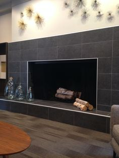 Contemporary fireplace / Daltile Dignitary series DR11 Governor Black 12x24 unpolished  finish.  Edges detail is chrome Schluter strips.