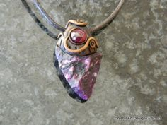Sugilite pendant with ruby Garnet