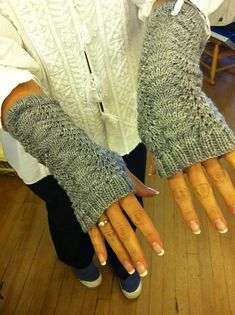 Ravelry: Feather and Fan Fingerless Mitts pattern by CharlotteKnits