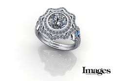 Custom diamond ring design with sapphire side accents. #imagesjewelers #customjewelry #jewelrydesign