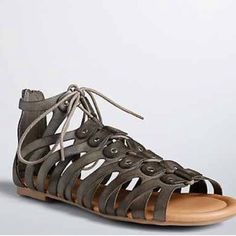 """Lace-Up gladiator sandals These sandals are a warm-weather requirement. Slightly distressed grey faux leather covers the zip on style; the look reaches """"fight to the death over"""" once you look at the lace up ties and silver tone stud detailing. New with tags. torrid Shoes Sandals"""
