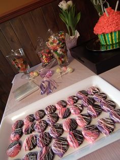 High Gloss Weddings  www.highglossweddings.com  My Famous Chocolate dipped Oreos - make with colors to match your theme... Always a BIG HIT!  and a colorful candy buffet for Young and old party goers!