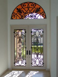 Tableaux® Faux Iron decorative grilles provide a personalized transformation to any entry. Iron Windows, Iron Doors, Windows And Doors, Sala Colonial, Iron Front Door, Window Inserts, Grill Door Design, Wrought Iron Decor, Welcome Signs Front Door