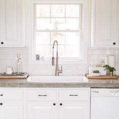 foundandco DIY kitchen renovation with concrete counters and painted cabinets. Cabinets in @benjaminmoore Decorators White and walls in Simply White, hardware from @potterybarn, Blanko Silgranit sink, Quickrete countertop mix, subway tile from @homedepot, and faucet from @loweshomeimprovement