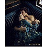 #7: Caitriona Balfe 8 inch by 10 inch PHOTOGRAPH Now You See Me Escape Plan Outlander from Knees Up Lying on Blue Striped Couch w/Sam Heughan kn