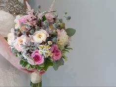 Beautiful mixed textures to include garden roses,Veronica,chamomile ,dusty miller, and spray roses create this romantic bouquet designed by Lilypots of Lake Geneva.
