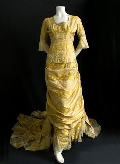 With a sweeping train and brilliant gold color, this gown dazzles the eye. Worn in 1876 by Harriet Louise Gorman.