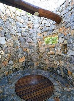 Outdoor shower with shower head installed in log over head