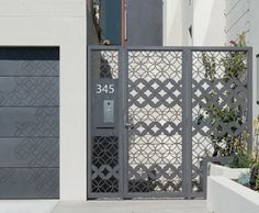 Gate in Graphite Pitted with custom design by Joanna Lukaszewicz