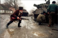 An elderly Chechen fighter with a most likely captured AK-74, First Chechen War.