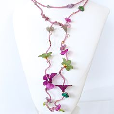 "This 50"" lariat necklace of life-like Lucite flowers is the perfect piece for the woman with unique style. Full of rich color and feminine details, you can wear this beautiful accessory many ways to c"