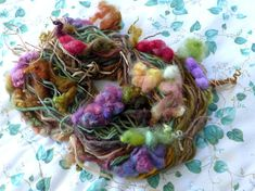 This is a lovely handspun art yarn that I spun with extreme texture! Colorful Grape clusters, leaves, and tendrils create a one of a kind luxury art yarn that is fun and exciting to work with!  This yarn was inspired by grapevines that are bursting with the fruit harvest. I love the rustic vines with the clusters of fruit hanging down, glowing with color. This will make a unique item!   **Each of my Art Yarns is one of a Kind. Your yarn will look like the sample shown but it may not be exact…