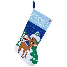 """#manythings Stocking is 19"""" tall and is made of a soft plush material.  Plays """" #Rudolph the Red Nosed Reindeer"""" when you press the red button.   Featuring Rudolp..."""