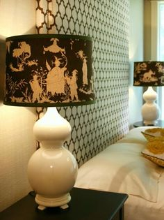 Brown Patterned Lampshade With Green Ribbon Trim on White Lamp Base