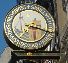 This clock is on the main shopping street in Scarborough and is above the Clarks shoe shop.