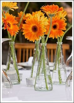 simple table arrangements for weddings candles gerbera - Google Search