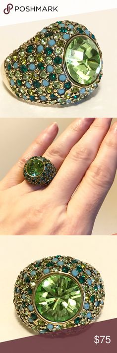 KJL Cocktail Ring A gorgeous gold-tone mounted ring with pave set crystal rhinestones surrounding a green glass cabochon.    Excellent condition with gentle wear on the gold band.    Jewelry pouch included. Kenneth Jay Lane Jewelry Rings