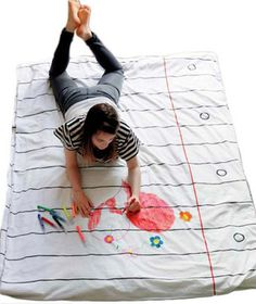 What a cool idea! A duvet cover kids can decorate themselves and then change by washing clean and starting over. Love it!