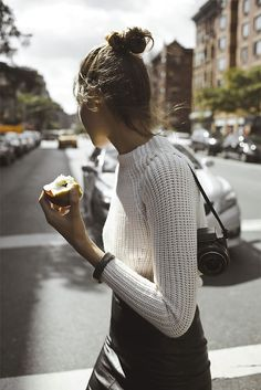 awesome street style - fitted turtleneck, black leather skirt. topknot.