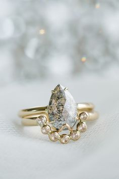 Alternative Engagement Ring// Dark Desires, Salt and Pepper Diamond Ring  - by Gardens of the Sun  Meet Star-cross'd lovers, all white hot heat and dark brooding sighs. The electricity in the air at twilight – that's her.