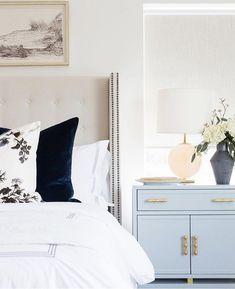 neutral bedroom, large nightstand, blue nightstand, large headboard