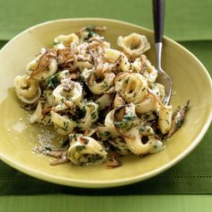 It's easy to turn these little twists of frozen-cheese-filled pasta into a meal with an easy mushroom sauce.