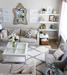 14. Modern Romance: Using light grays and varying shades of white lets you add plenty of design elements without things getting too visually crowded. The style of the LIATORP coffee table pairs perfectly with the four matching white frames on the wall. (via Oh My Dear)