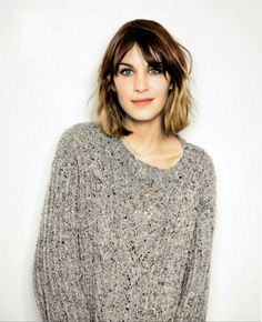 Do as Ms. Alexa Chung does.  Cozy sweater and a fresh face.  My 2012 winter staple.