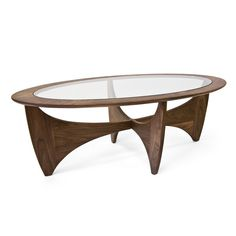 Aeon Furniture The soft curves and natural grain patterns of the solid American walnut frame of Aeon's Angela coffee table are complemented by its tempered glass top making it the perfect table for your casual lifestyle cartons). G Plan Coffee Table, Coffee Table With Drawers, Oval Coffee Tables, Mid Century Coffee Table, Glass Top Coffee Table, Contemporary Coffee Table, Contemporary Furniture, Contemporary Design, Modern Design
