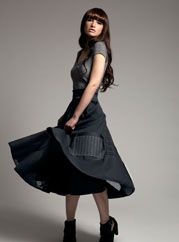 PieceXPiece takes discarded fabric swatches and frankensteins them into beautiful garments. Love this skirt!