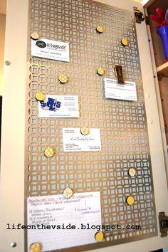 On the V Side: Kitchen Cabinet Magnet Board [Tutorial]    ***great idea - decorative metal grate inside a cupboard instead of corkboard