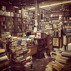 This bookstore in Vancouver, BC, isrumored to have columns of books in the basement placed to help support the sagging floorboards. There is hardly a patch of wood peeking out from the many vintage rugs sprawled across the space between mountains of books of every genre.  It smells like thin yellowing pages and old memories, and the floor creaks with every step.