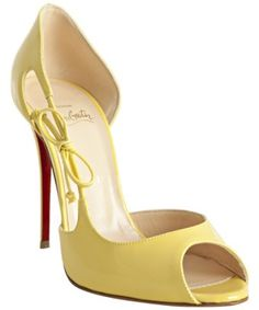 peep-toe D'Orsay yellow heels. Wish I could afford these, they go PERFECT with my dress for next weekend