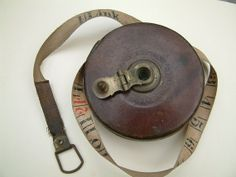 Antique leather bound 66' measuring tape by John Rabone England.
