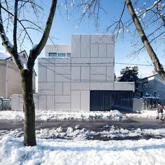 In Ljubljana, Slovenia, this home was designed by OFIS arhitekti with a perforated exterior with diagonal crosses that result in a dramatic facade.