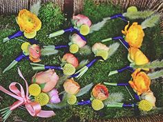 Colorful assortment of wedding boutonnieres. Petalworks, Northern CA.