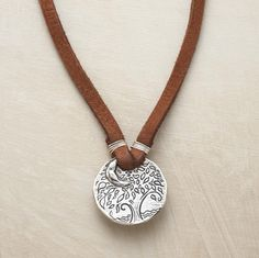 "Jes MaHarry's suede-strung, sterling silver pendant necklace urges everyone to ""love beyond the moon and stars."" Front displays her popular old oak. Lobster clasp. Handmade in USA. 18""L."