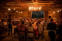 Dinner in the barn at the 5th annual Lowcountry Field Feast. Photo Credit: Brennan Wesley. #GardenandGun