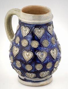 Westerwald Stoneware jug with impressed hearts. I like the mix between the elegant glaze and the textured pattern. c. 1690 #salt_glaze #cobalt_blue #westerwald