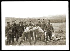 Two Jewish soldiers in the Slovak army wrestle while others look on