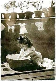 Washing dolly' clothes. Good, old fashioned play for kids. Imaginative, role play, water play, emotional play for little children