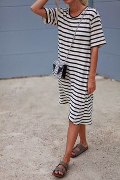 Black and white striped t-shirt dress, grey birkenstocks and a black and white printed Saint Laurent bag