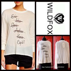 """WILDFOX Looking For Love Walk of Shame Tee WILDFOX Looking For Love Walk of Shame Tee NEW WITH TAGS RETAIL PRICE: $88   * Relaxed fit; Purposely subtly 'distressed' look.   * Crew neck & pullover style, & super lightweight knit; Graphic logo detail on front.  * Approx 26"""" long.  * Long sleeves.  Fabric: 50% Cotton & 50% Polyester  Color: Vintage Lace Combo, made in the USA Item:   No Trades ✅ Offers Considered*✅ *Please use the blue 'offer' button to submit an offer. Tops Tees - Long Sleeve"""
