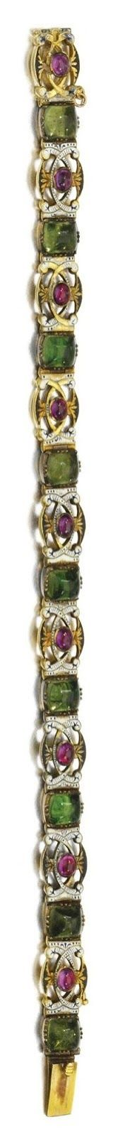 Enamel and ruby bracelet by Carlo Giuliano, made between 1874 and 1895. Of pierced scrollwork design, alternating between green paste stones and elaborately designed links of monochromatic enamel and cabochon rubies. Via Diamonds in the Library.