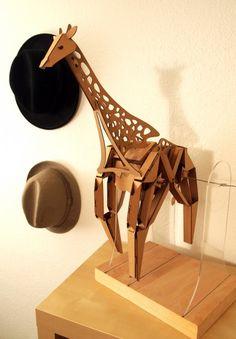 Kinetic Cardboard Creatures  http://laughingsquid.com/kinetic-creatures-cardboard-walking-animal-sculptures/