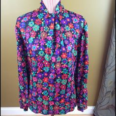 Colorful Vintage-Style Blouse Beautiful flowy blouse in bright colors. Very pretty. Slits on the sides. Buttoned sleeves. High neck w/ zip closure in back. Hem unraveled a bit around the bottom back and at side slits but can easily be sewn back. Priced accordingly. Great condition. There are no tags so I provided measurements to help with sizing. If I had to guess, I'd say it's somewhere between Medium and Large. Sleeves: 23.5 inches Length: 26 inches Bust: 21 inches Material: Silky Rayon…