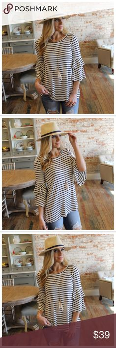 """Navy striped tiered ruffle sleeve tunic Modeling size small  96% Rayon 4% Spandex  BUST: S-18"""", M-19"""", L-20"""".  LENGTH: S-27"""", M-28"""", L-29"""".  IRPD10850202.2227-1P Infinity Raine Tops Tunics"""