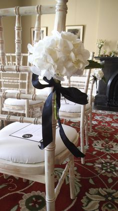White hydrangea pew end by The Posy Barn
